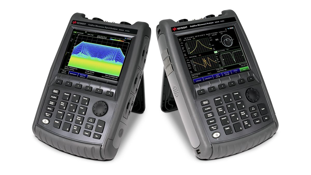 Three FieldFox handheld analyzers showing a real-time spectrum analysis measurement, a four window display S-parameter measurement, and a distance to fault measurement